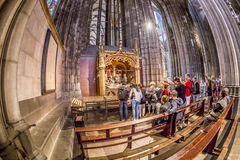 Service held in Central nave. COLOGNE, GERMANY- SEP 7, 2014: church service held in the cathedral in Cologne, Germany. The dome is Germanys most visited landmark royalty free stock image