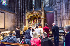 Service held in Central nave. COLOGNE, GERMANY- SEP 7, 2014: church service held in the cathedral in Cologne, Germany. The dome is Germanys most visited landmark stock photography