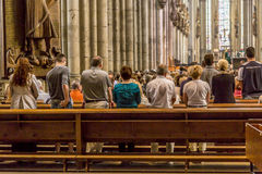 Service held in Central nave. COLOGNE, GERMANY- SEP 7, 2014: church service held in the cathedral in Cologne, Germany. The dome is Germanys most visited landmark stock photo