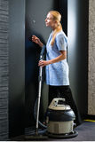 Service in hotel, maid with vacuum cleaner Royalty Free Stock Photo