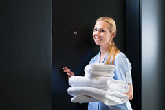Service in hotel, maid with vacuum cleaner Royalty Free Stock Images