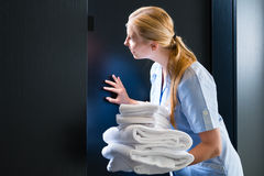 Service in the hotel, towels being changed Stock Photos