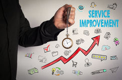 Service Improvement concept. Red Arrow and Icons Around. Man holding chain clock on white background Royalty Free Stock Photography