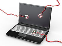 Service for laptop repair. Laptop and stethoscope Stock Photo