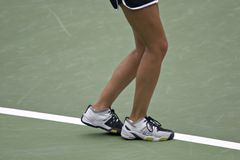 Service Line. Tennis player's feet positioned for a serve Stock Images