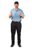Service Man Approving with Thumbs Up. A blue collar worker standing, facing the camera with thumbs up in approval. This man could be a technician, installer Royalty Free Stock Photography