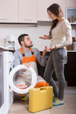 Service man near washing machine Royalty Free Stock Photos
