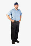Service Man Standing with Hands on Hips. A cheerful service technician ready to be of service with your next project. This man could be a plumber, mechanic Royalty Free Stock Photography