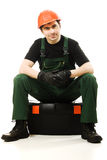 Service man wearing in helmet. Service man wearing helmet and overall holding black toolbox over white Stock Photo