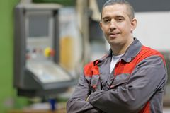 Service man worker at factory CNC machine background Stock Photography