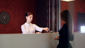Service manager at hotel lobby meets visitor. 4K. stock video