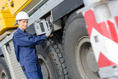 Service mechanic fixing heavy truck. Service mechanic fixing a heavy truck Stock Image