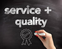 Service and Quality Text on Board with Ribbon Royalty Free Stock Image