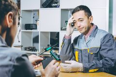 Service repair electronics. Worker specialist fix gadget stock images