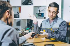 Service repair electronics. Worker specialist fix gadget royalty free stock photos