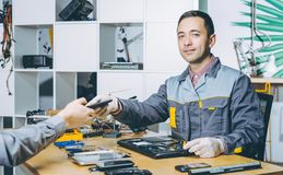 Service repair electronics. Worker specialist fix gadget stock image