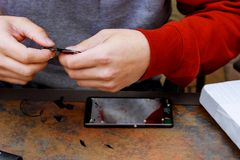 Service and repair service for smartphone with broken glass Stock Photos