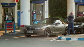 Service for rich, gas station timelapse blonde in elite car. Stock footage stock footage