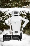 Service robot is shovelling snow stock image
