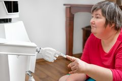 service robot is touching with his finger the finger of an mentally disabled woman royalty free stock images