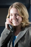 Service with a smil. A business woman in the workplace Stock Photography