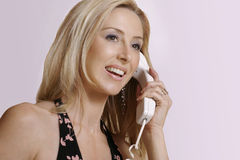 Service with smile. Female greets a telephone caller Royalty Free Stock Photos
