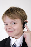 Service with a smile. A young man on a cordless headset smiling. Childs play of customer service Stock Photography