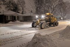 Free Service Snow Plowing Truck Cleaning Residential Street During Heavy Snowstorm, Toronto, Ontario, Canada. Royalty Free Stock Photography - 138039737
