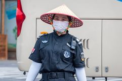 Service staff in the park of an extinct volcano Rock Hill Volcanoe Haikou. Chinese woman in uniform rangers. Haikou, Hainan, China - May 11, 2019: Service staff royalty free stock photos