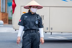 Service staff in the park of an extinct volcano Rock Hill Volcanoe Haikou. Chinese woman in uniform rangers. Haikou, Hainan, China - May 11, 2019: Service staff stock images