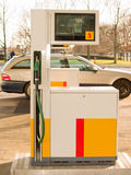 Service Station - Fuel nozzle with car Stock Photography