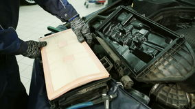 In service station mechanic installs a new air filter inside the box. stock video footage