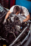 Service station worker diagnosing vehicle Stock Photos