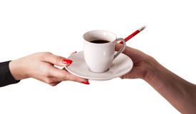 Service. Two hands with a cup of coffee stock photo