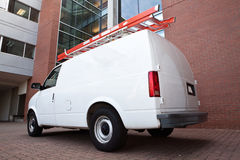 Service Van from back. Service Van by commercial building back angle Stock Photos