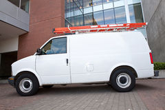 Service Van from side. Service Van by commercial building side angle Stock Photo