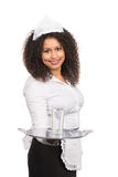 Service woman offers a glass of water Royalty Free Stock Photos