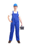 Service woman with toolbox. Service woman wearing blue helmet and overall holding black toolbox over white Stock Photo