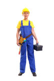 Service woman with toolbox. Service woman in blue overall  and yellow helmet wearing leather toolbelt with tools, holding black toolbox over white Stock Photos