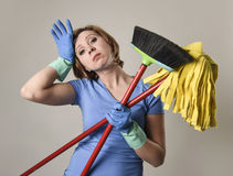 Service woman in washing rubber gloves carrying cleaning broom m Royalty Free Stock Images