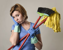 Service woman in washing rubber gloves carrying cleaning broom m Stock Photography