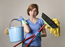 Service woman in washing rubber gloves carrying cleaning bucket Stock Photography