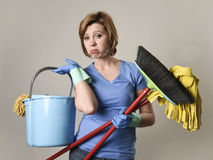 Service woman in washing rubber gloves carrying cleaning bucket Stock Image