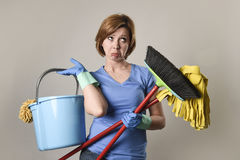 Service woman in washing rubber gloves carrying cleaning bucket Royalty Free Stock Photos