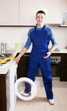 Service worker repairing washing machine Royalty Free Stock Images