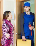 Service worker in uniform came to housewife Stock Image