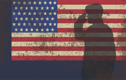 Serviceman on the background of the US flag.  Royalty Free Stock Photography
