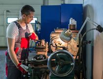 Serviceman in a car workshop Stock Photography