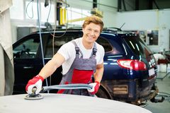 Serviceman in car workshop Royalty Free Stock Photo
