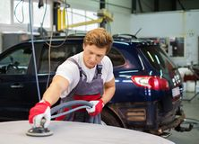 Serviceman in a car workshop Stock Photo